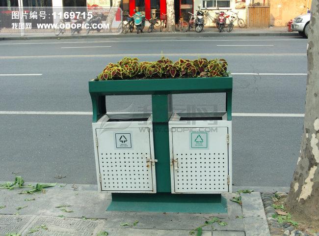 模板下载 绿色环保垃圾箱上的鲜花正版图片下载图片