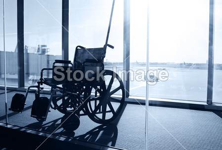 Wheelchair Service in Airport Terminal. Window