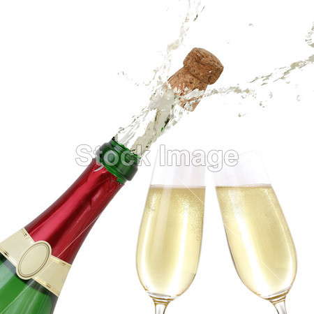 Popping cork from a Champagne bottle图片素