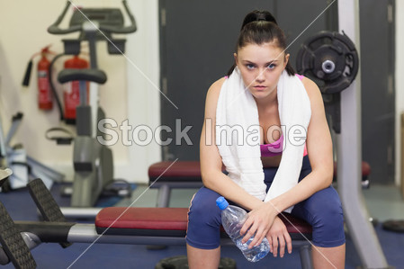 Portrait of a tired and thoughtful woman sitting i